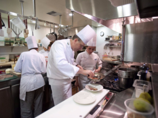 Chef-instructor Aaron Brown with CIA Greystone baking & pastry arts students at The Bakery Café.