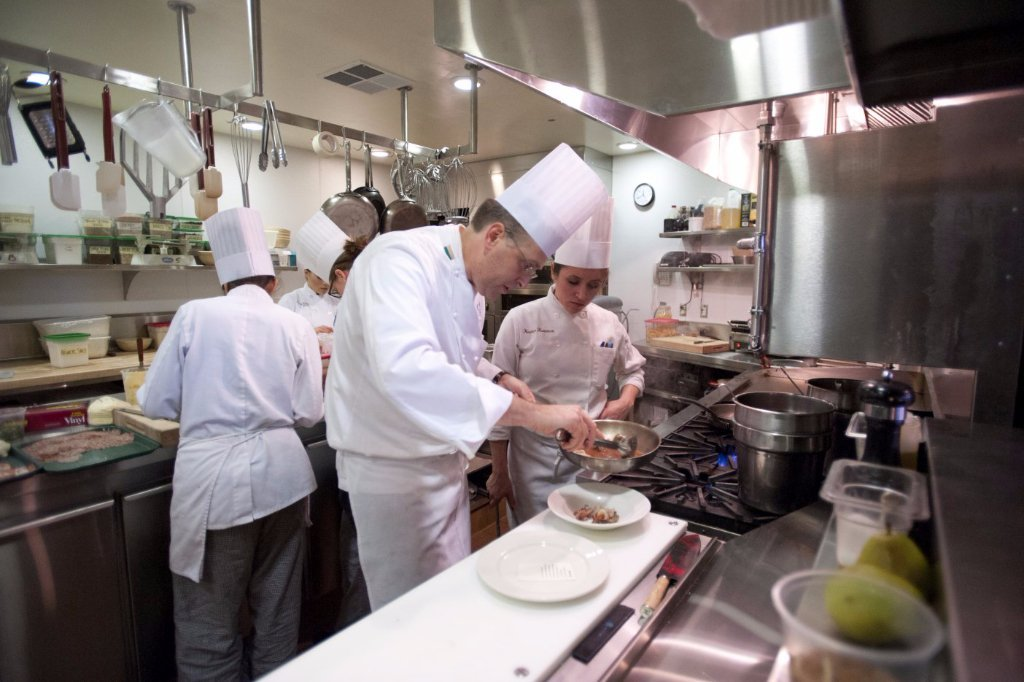 Chef-instructor Aaron Brown behind the scenes with CIA baking and pastry arts students